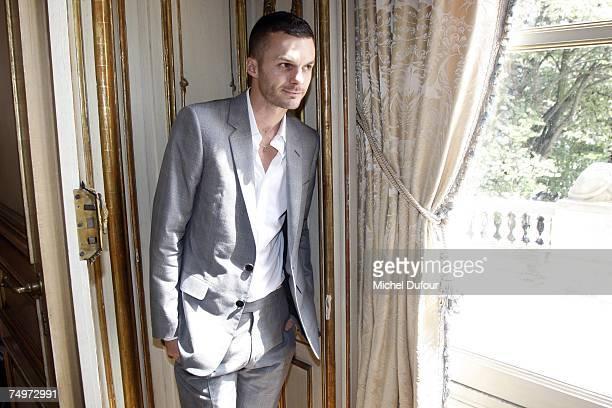 After Heidi Slimane new designer Chris Von Asch poses at the Dior Fashion show during Paris Menswear Fashion Week SpringSummer 2008 at the 34 av Foch...