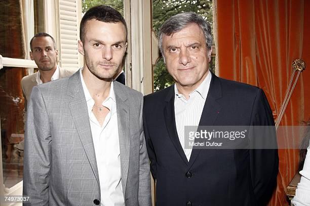 After Heidi Slimane new designer Chris Von Asch poses with Sidney Toledano at the Dior Fashion show during Paris Menswear Fashion Week SpringSummer...