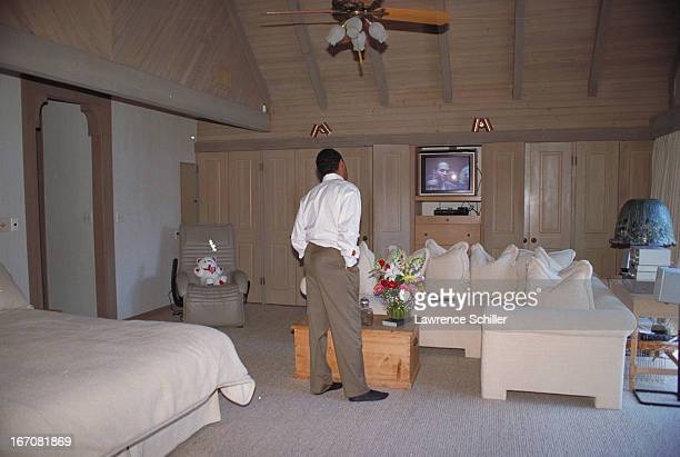 After his acquittal on double murder charges American former professional football player and actor OJ Simpson stands in a bedroom in his home and...