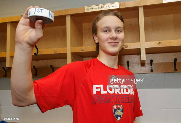 After his NHL debut against the Ottawa Senators Henrik Borgstrom of the Florida Panthers poses for a photo with the game puck in the locker room at...