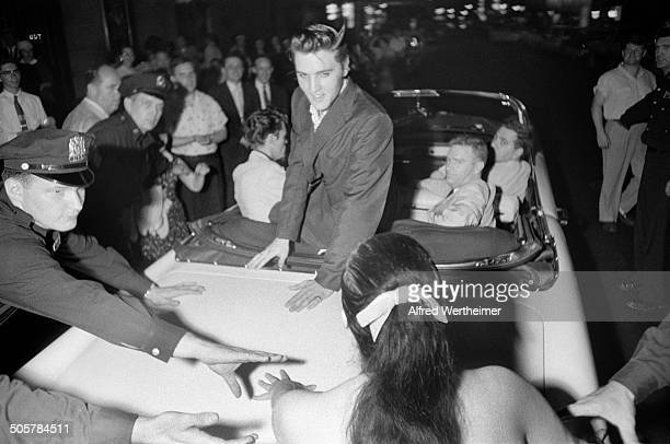 Alfred Wertheimer/Getty Images After his performance on the 'Steve Allen Show' at the Hudson Theatre American musician Elvis Presley leans out of a...