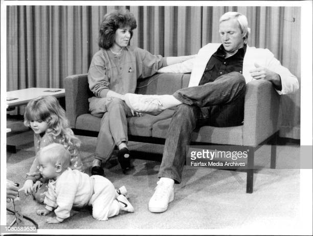 After his return to Australia yesterday Greg Norman conducts a press interview watched by his wife Laura while their children Morgan Leigh and...