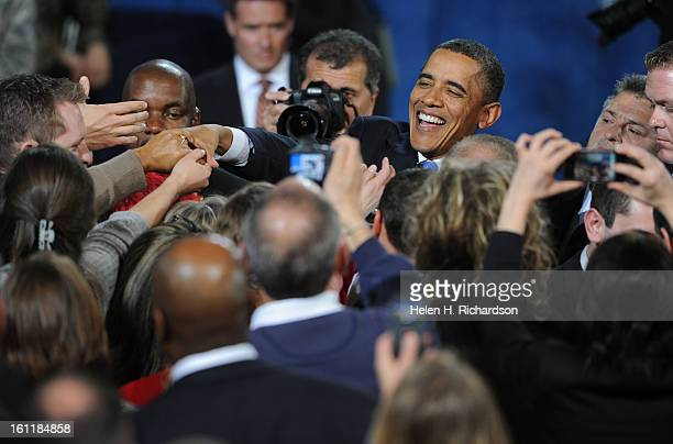 After his speech President Barack Obama shakes hands with his many supporters President Barack Obama made an appearance at Buckley Air Force base in...