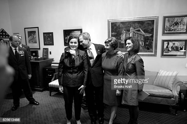 After his State of the Union Address President George W Bush hugs his sister Dorothy Koch and the First Lady His sisterinlaw Margaret looks on