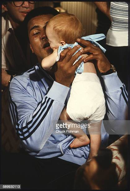 After his victory in a championship bout American heavyweight boxer Muhammad Ali holds his infant daughter Laila New Orleans Louisiana September 1978