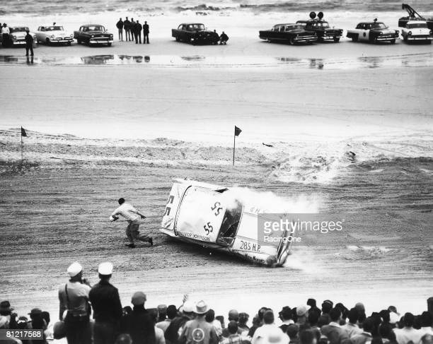 After hooking a rut in the sand Junior Johnson rolled his 1956 Pontiac several times down the beach but managed to escape uninjured through the back...