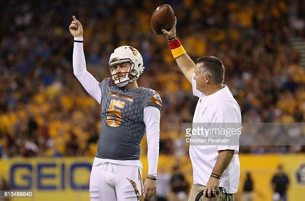 After kicking a 46 yard field goal place kicker Zane Gonzalez of the Arizona State Sun Devils is congratulated by head coach Todd Graham for breaking...