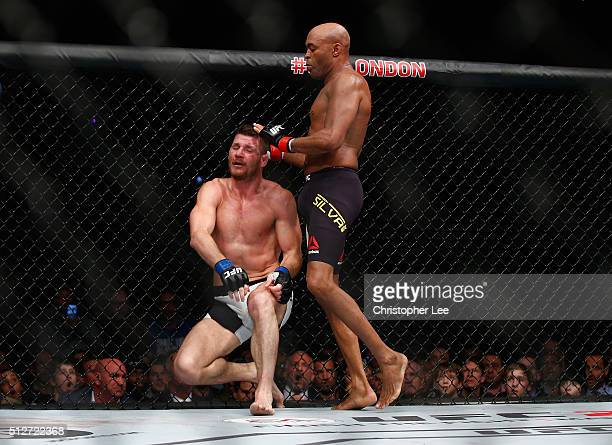 After knocking out Silva's gumshield Michael Bisping of Great Britain stops fighting Anderson Silva of Brazil but Silva fights on without his...