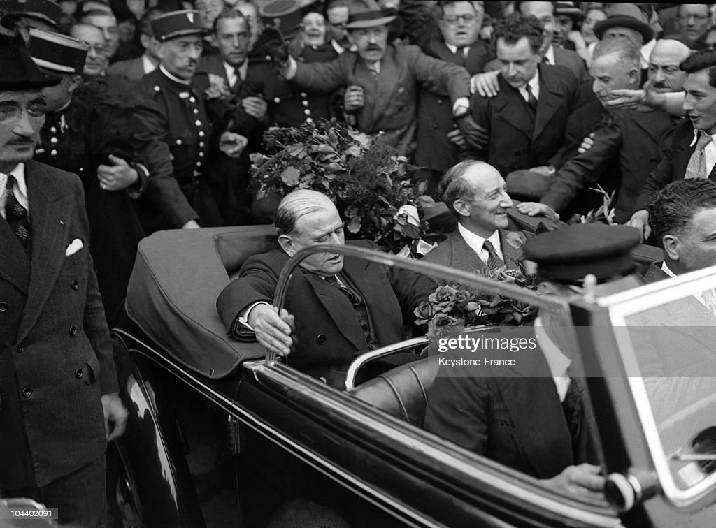 Munich conference in 1938 daladier returning to france pictures after landing at bourget airport french prime minister edouard daladier leaves the airport with georges platinumwayz