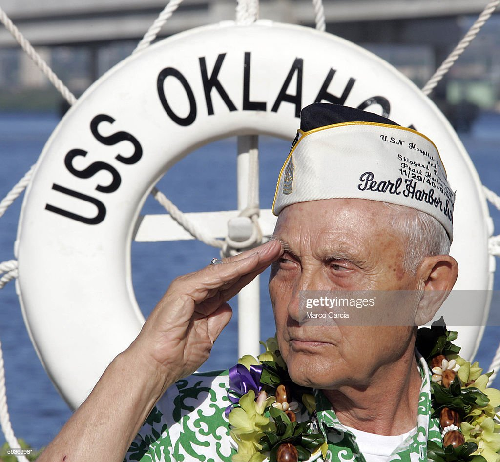 After laying a memorial wreath, USS Oklahoma and Pearl Harbor survivor Sterling Cale salutes the flag during the ceremony honoring the 64th anniversary of the surprise attack on Pearl Harbor, December 7, 2005 at Pearl Harbor, Hawaii. Around the country, Pearl Harbor survivors and others paid tribute to those lost during the December 7, 1941 Japanese bombing of Pearl Harbor.