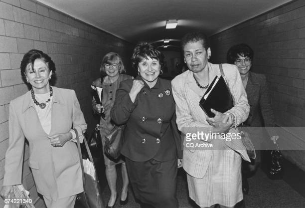 After loosing in race for Ranking member of the Budget Committee Rep Louise Slaughter DNY is escorted by friends Rep Nancy Pelosi DCalif Rep Lynn...