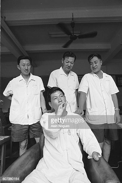 After losing both hands in a work-related accident, Kao Tien Sue demonstrates his newfound ability to hold a cigarette after undergoing a toe graft,...