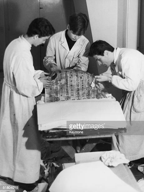 After major floods in Italy restorers examine damaged mediaeval manuscripts at a laboratory in the Vatican 15th November 1966