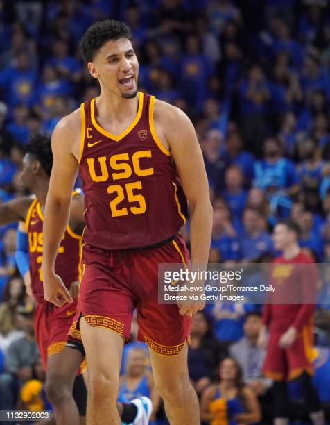 After making a 3pointer USC Trojans forward Bennie Boatwright has a remark for the Bruins bench as he runs back up the court at Pauley Pavilion in...