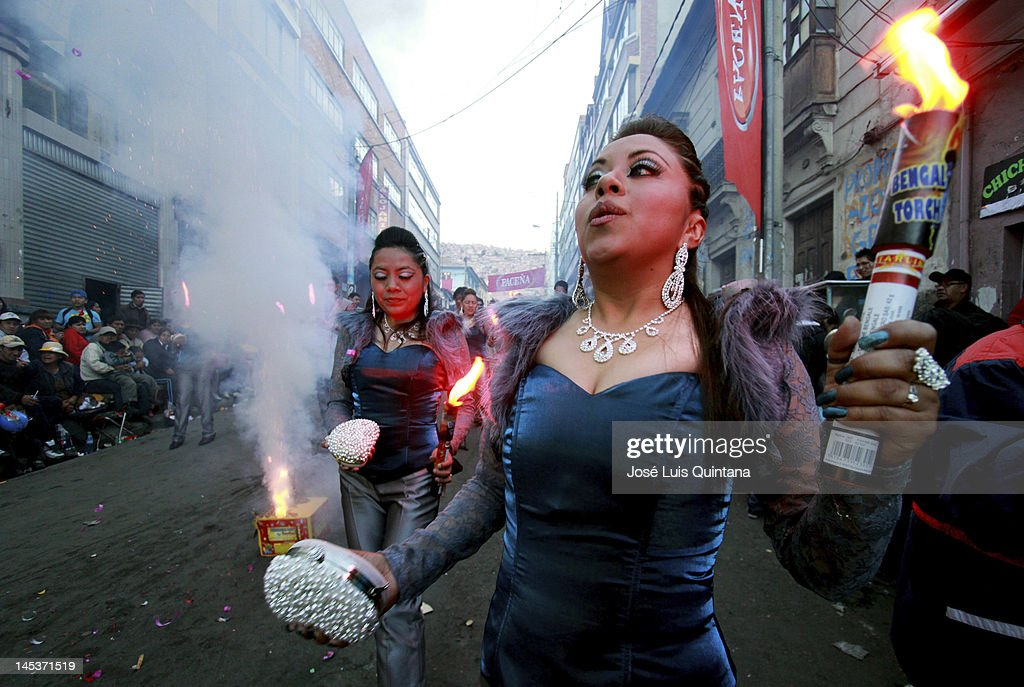 After making a promise in the temple of Great Power, in the neighborhood of Chijini, dancers dance with devotion and faith carrying a colorfull torch in the pre entry of Great Power on May 25, 2012 in La Paz, Bolivia. 30 000 dancers from 64 fraternities participate in the final essay of the feast of Jesus of Great Power a traditional folk party on June 02, 2012.