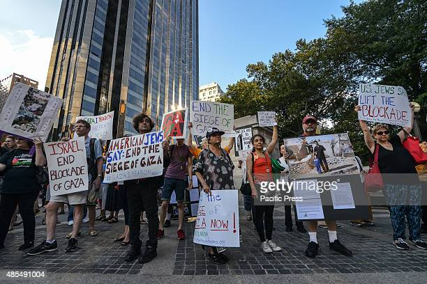 After marching from the American Museum of Natural History demonstrators rally in Columbus Circle displaying their signs Demonstrators rallied at the...