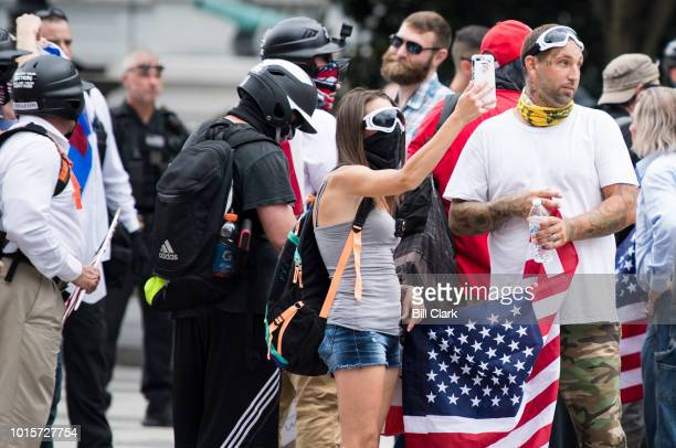 After marching to Pennsylvania Ave by the White House Unite the Right protesters wait for a police escort to their rally site in Lafayette Square on...