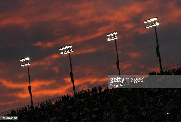 After multiple rain delays, fans watch the second of two NASCAR Gatorade Duels as the sun sets at Daytona International Speedway February 16, 2006 in...