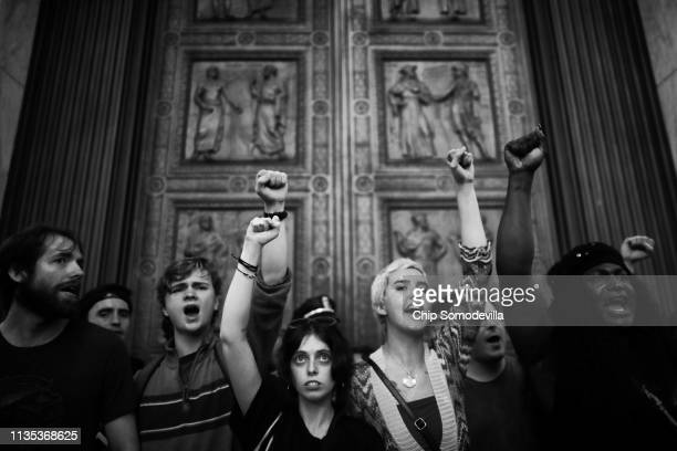 After over running police barricades protesters chant as they block the doors to the US Supreme Court while demonstrating the confirmation of...