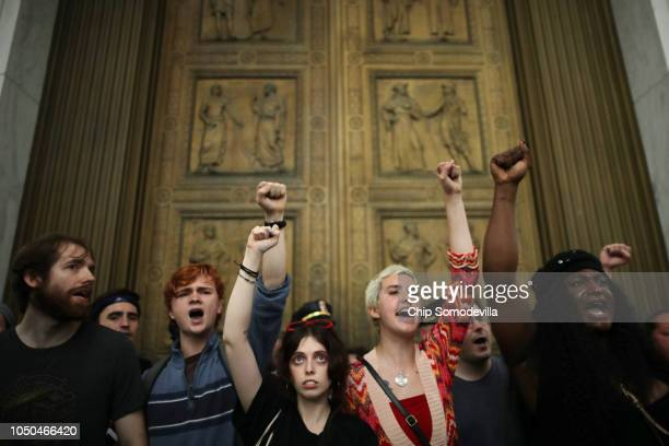 After overrunning police barricades protesters chant as they block the doors to the US Supreme Court while demonstrating against the confirmation of...