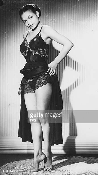 After performing in in the revue 'New Faces of 1952' American singer and actress Eartha Kitt gets changed before singing at the Blue Angel club in...