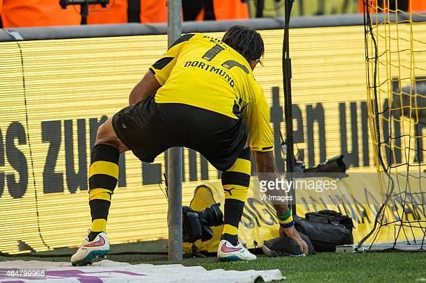 after PierreEmerick Aubameyang of Borussia Dortmund scored he picked up a mask bihind the goal during the Bundesliga match between Borussia Dortmund...