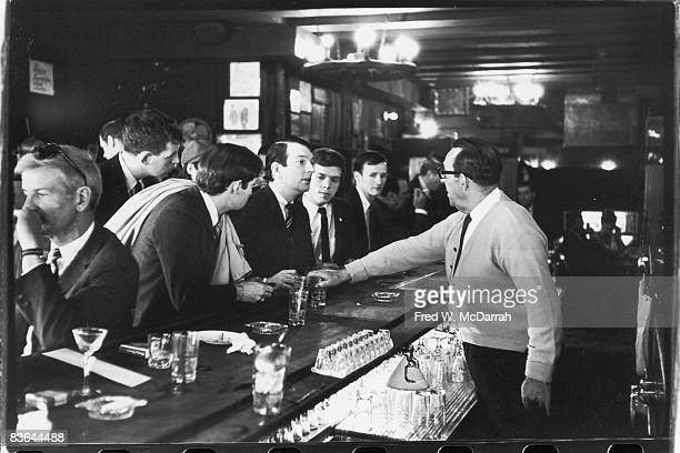 After pouring their drinks a bartender in Julius's Bar refuses to serve John Timmins Dick Leitsch Craig Rodwell and Randy Wicker members of the...