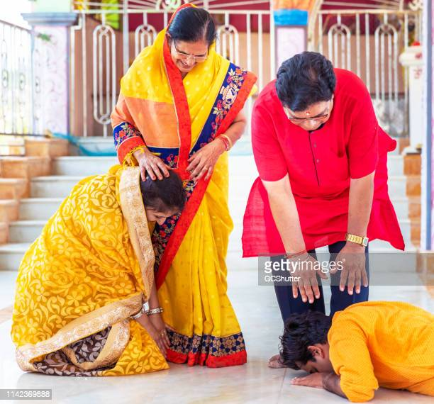 after prayers taking blessings from the elders - hinduism stock pictures, royalty-free photos & images
