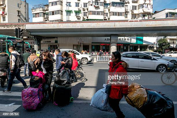 After purchasing young Taobao shop owners throng to walk on the street outside an ecommerce base in Hangzhou where wholesalers supply clothes goods...