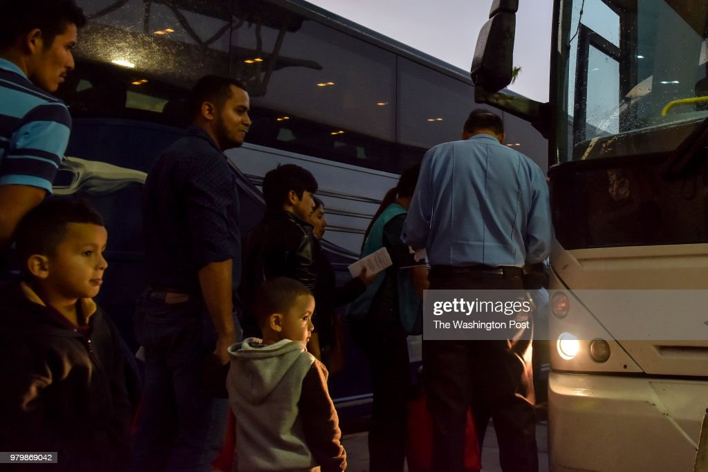 After receiving assistance from the Catholic Charities RGV Humanitarian Respite Center, migrant families from Mexico and Central America wait in line at the Central Station Bus Terminal to board buses for transport to various destinations across the United States on Tuesday, June 19, 2018, in McAllen, TX. The families have been granted access to the United States while they await hearings or seek asylum. Waves of migrants from Mexico and Central America continue to seek refuge in the United States amid the growing uproar over the decision to separate migrant families at the U.S./Mexico border.