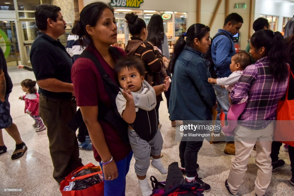 After receiving assistance from the Catholic Charities RGV Humanitarian Respite Center, Maydei (accent over the e and i) Galdames (cq), 25, of Honduras, her 6-month-old baby, and other migrant families from Mexico and Central America wait in line at the Central Station Bus Terminal to obtain bus tickets for transport to various destinations across the United States on Tuesday, June 19, 2018, in McAllen, TX. Waves of migrants from Mexico and Central America continue to seek refuge in the United States amid the growing uproar over the decision to separate migrant families at the U.S./Mexico border.