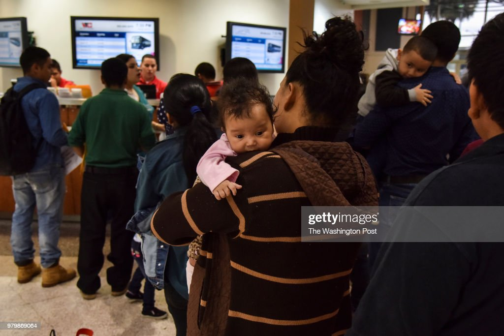 After receiving assistance from the Catholic Charities RGV Humanitarian Respite Center, migrant families from Mexico and Central America wait in line at the Central Station Bus Terminal to obtain bus tickets for transport to various destinations across the United States on Tuesday, June 19, 2018, in McAllen, TX. The families have been granted access to the United States while they await hearings or seek asylum. Waves of migrants from Mexico and Central America continue to seek refuge in the United States amid the growing uproar over the decision to separate migrant families at the U.S./Mexico border.