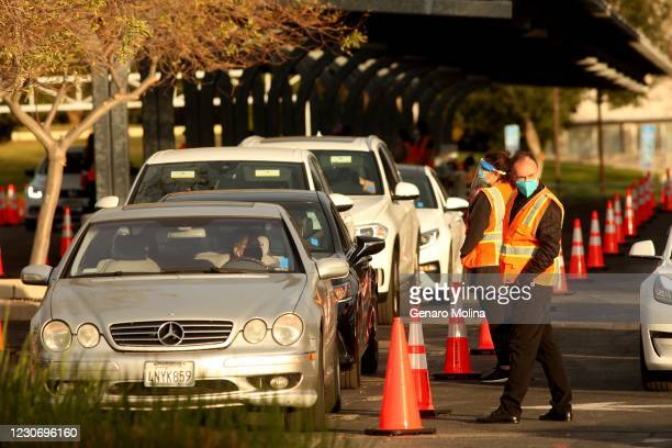 After receiving the vaccine against COVID-19 motorists wait in a staging area for 15 minutes to make sure there are no side effects from the shot on...