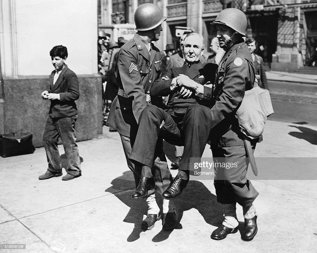 Sewell Avery Carried by Two Soldiers : News Photo