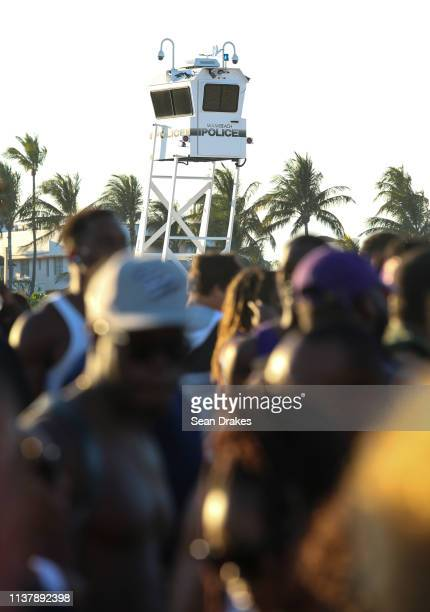 After reports of raucous behavior and crime Miami Beach Police Department dispatched 301 officers to perform surveillance from elevated booths sea...