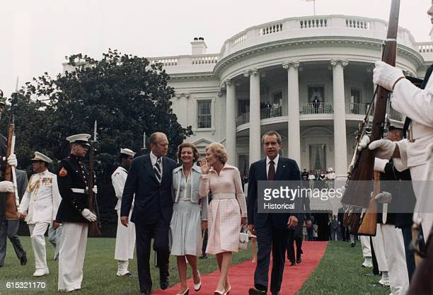 After resigning President Nixon leaves the White House with his family vice president Ford and his wife