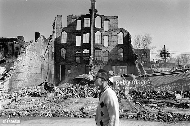 After riots erupted in response to the killing of civil rights leader Martin Luther King Jr a man walks past the rubble of a burned out building in a...