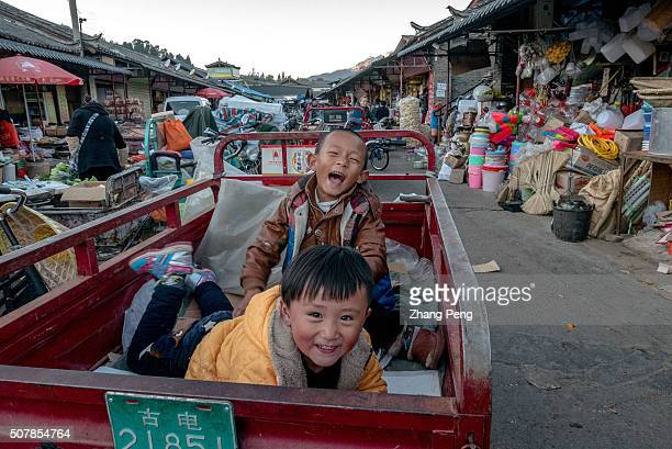 After school local boys play on a freight cart in the market Zhongyi market located at the southern gate of Dayan ancient city is the biggest market...