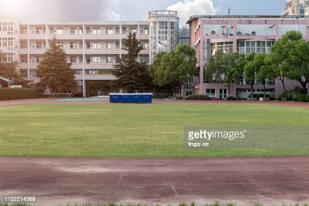after school, the playground of the chinese elementary school allows the surrounding residents to enter the exercise. - center street elementary stock pictures, royalty-free photos & images