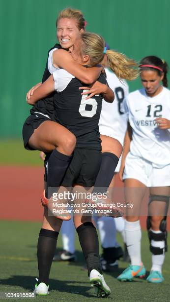After scoring a goal, Chino Hills' Amanda Ball leaps into the arms of teammate Sydney Adams to celebrate in the 2014 CIF SoCal Regional Soccer...