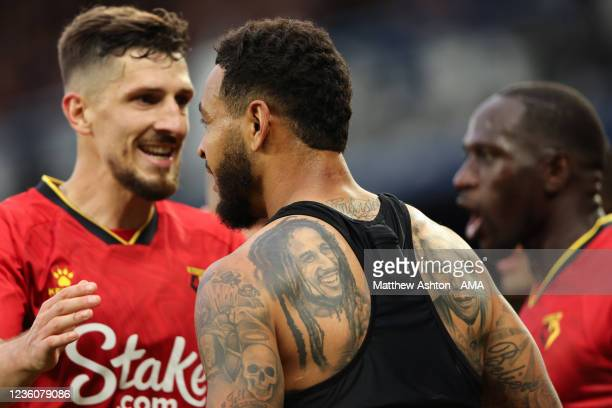 After scoring a hat-trick, Joshua King of Watford celebrates after scoring a goal to make it 2-4 showing off his black history tattoos including Bob...