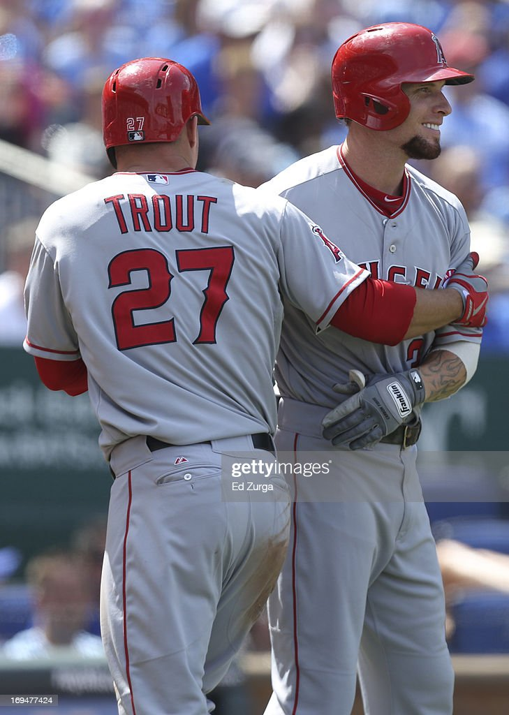 After scoring a Mark Trumbo single, Mike Trout #27 of the Los Angeles Angels of Anaheim celebrates with Josh Hamilton #32 in the eighth inning during a game against the Kansas City Royals at Kauffman Stadium on May 25, 2013 in Kansas City, Missouri.