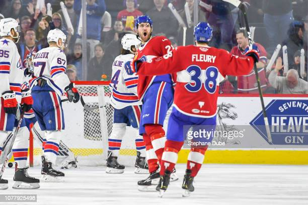 After scoring his goal Alexandre Grenier of the Laval Rocket celebrates with Cale Fleury of the Laval Rocket against the Rochester Americans at Place...