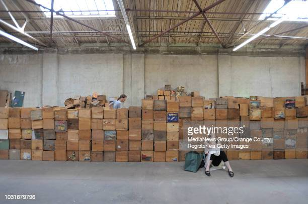 USA After searching for books Leah Lesser rests among crates stacked in the back roomof Acres of Books in Long Beach CA on July 10 2010 The...