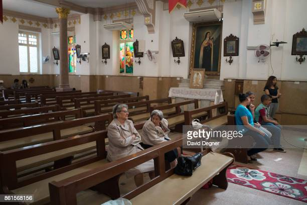 After services a few people stay behind to pray in the old sanctuary of the Holy Family Church during Holy Week on April 13 2017 in Cairo Egypt