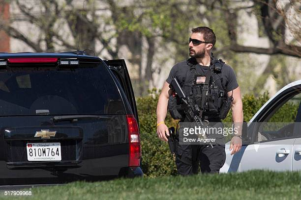 After shots were reportedly fired at the US Capitol Visitor Center Secret Service agents walk outside of the White House while the grounds were...