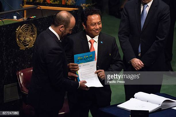 After signing the Global Climate AgreementTommy Remengesau President of Palau submits his governments instrument of ratification for the agreement...
