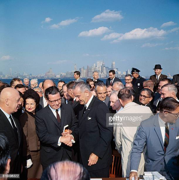 After signing the new liberalized US immigration bill into law today October 3rd President Lyndon Johnson shook hands with some of the New York City...