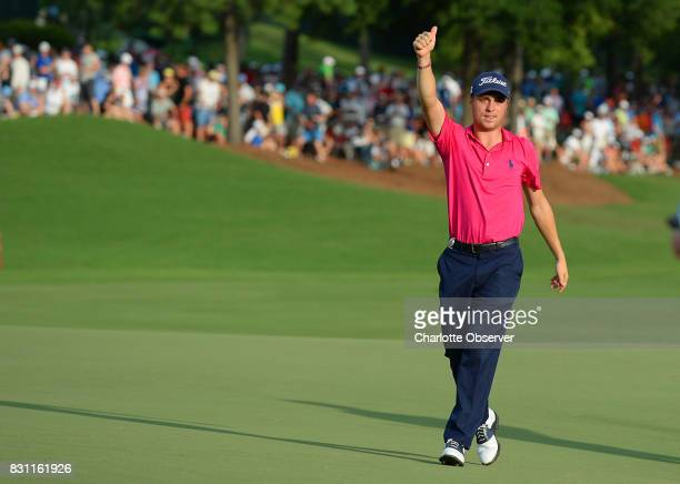 After sinking his final putt on the 18th green Justin Thomas gives the thumbs up to the cheering gallery at the PGA Championship at Quail Hollow Club...