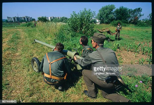 After Slovenia declares independence from Yugoslavia on June 25 the Slovenian territorial army takes up a defensive position in the capital |...
